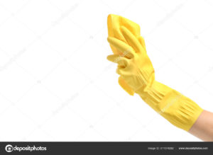 Female hand in glove holding cleaning rag on white background
